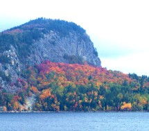 Magnificent view of Mount Kineo across Moosehead Lake in Maine showing bright fall foliage colors